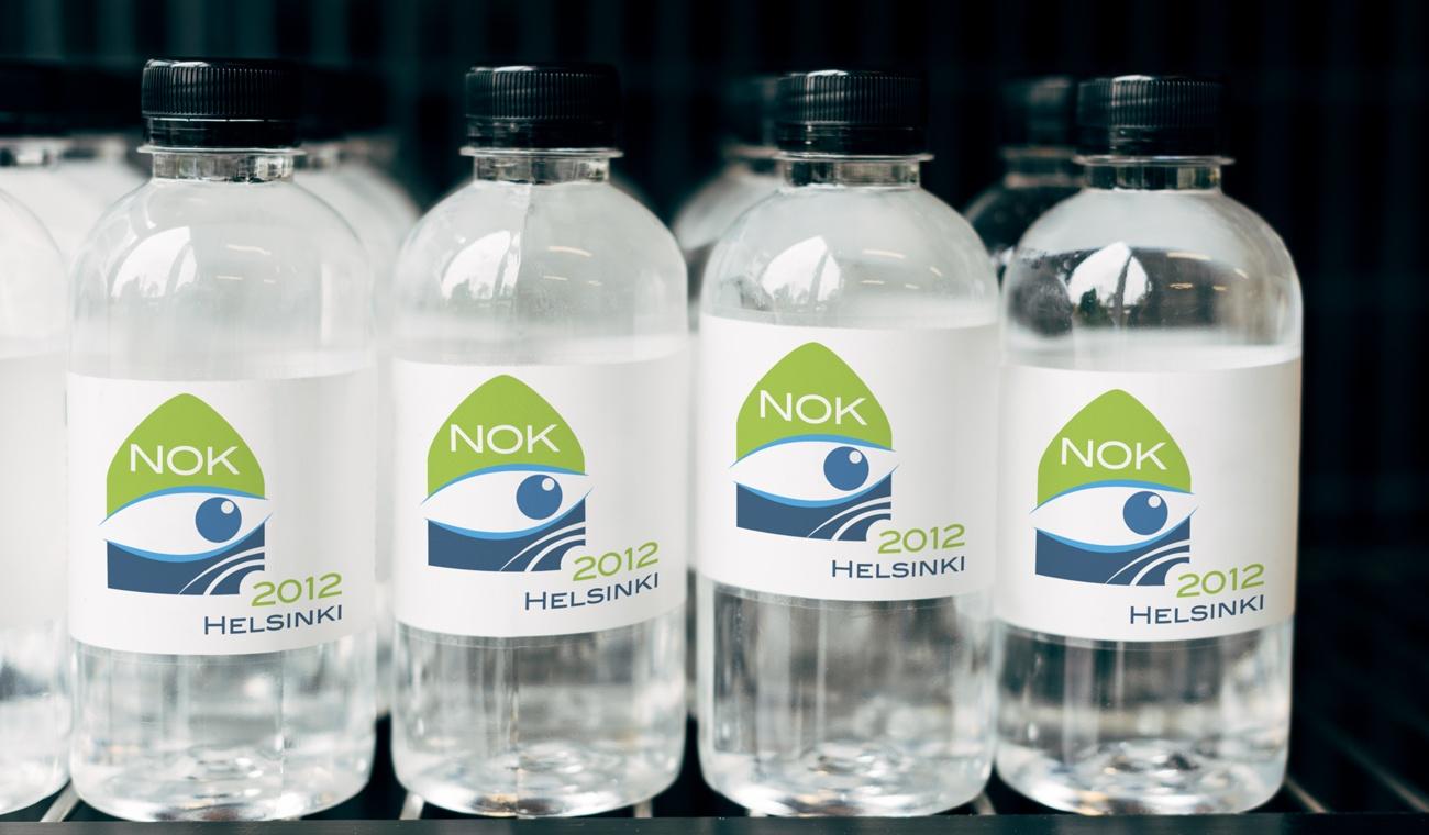 NOK 2012 logo drankflesjes